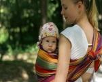 Как правильно носить ребенка